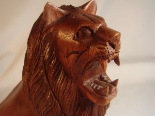 Bali Hand Carved Seated Roaring Lion Wood Sculpture