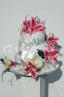 Fuchsia Stargazer Lily and Ivory Orchid Wrapping Wedding Cake Topper