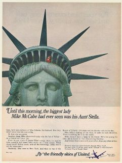 1966 Mike McCabe on Top of Statue of Liberty United Airlines Print Ad