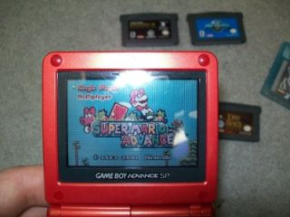 Red Nintendo Game Boy Advance SP with 7 Games 8 Game Cases and Charger