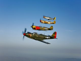 A P 36 Kingcobra, Two Curtiss P 40N Warhawks, and a P 51D Mustang in Flight Photographic Print by Stocktrek Images
