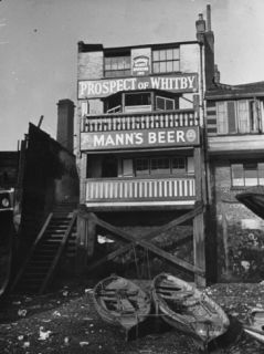 Londons Oldest Riverside in the Prospect of Whitby Featuring a Sign for Manns Beer Premium Photographic Print by Carl Mydans