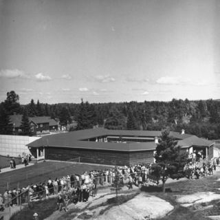 A View of People Gathering to See the Birth Place of the Dionne Quintuplets Premium Photographic Print by Hansel Mieth