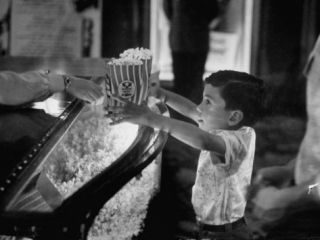 Boy Buying Popcorn at Movie Concession Stand Premium Photographic Print by Peter Stackpole
