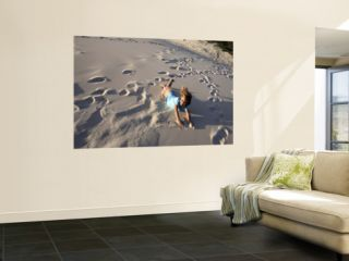 Young Girls Rolling Down Sand Dune Wall Mural by Cathy Finch
