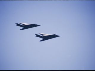A Pair of F 117 Fighters Fly During the 50Th Air Force Anniversary Air Show in 1997 Photographic Print by Marc Moritsch