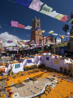Decorations for the Day of the Dead Festival with Iglesia De San Rafael in the Background Photographic Print by Richard Maschmeyer