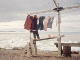 Alaskan Woman Hanging Her Laundry to Dry Along the Edge of an Ice Sheet Premium Photographic Print by Ralph Crane