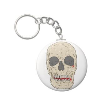 Evil, bloody and ravaged skull key chains