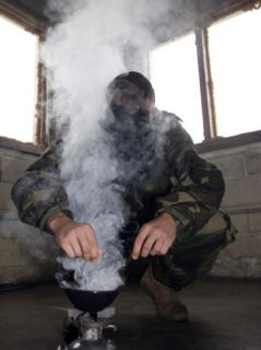 A Marine Fills the Marine Corps Air Station Futenma Gas Chamber with More Cs Gas Photographic Print by Stocktrek Images