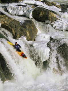 A Kayaker Soars Down he Ice Covered Grea Falls of he Poomac River Phoographic Prin by Skip Brown
