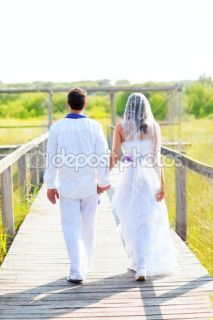 Couple happy in wedding day walking rear view  Stock Photo © TONO