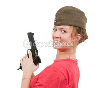 Girl in overseas cap holding gun.  Stock Photo © Daria Filimonova