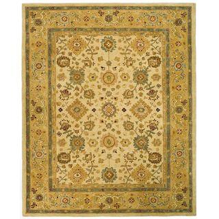 Handmade Heirloom Ivory/ Gold Wool Rug (96 x 136)