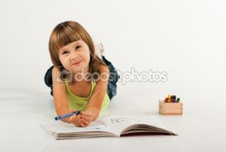 Cute little girl with drawing book  Stock Photo © Viktoria
