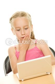 Surprised little girl with laptop  Stock Photo © Andrejs Pidjass