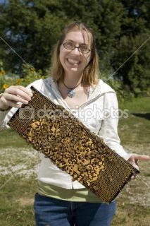 Brave Woman Holding Beehive  Stock Photo © Catherine Murray #2413890