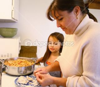 Little girl helping Mom cook  Stock Photo © Gregory Dean #2438721